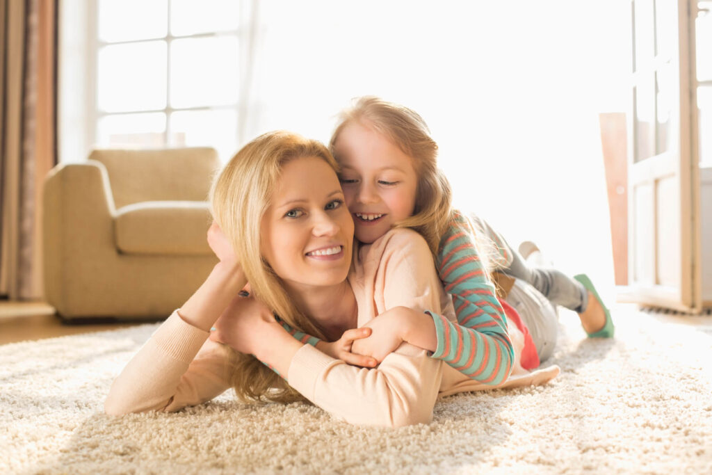 Mother with daughter lying on floor